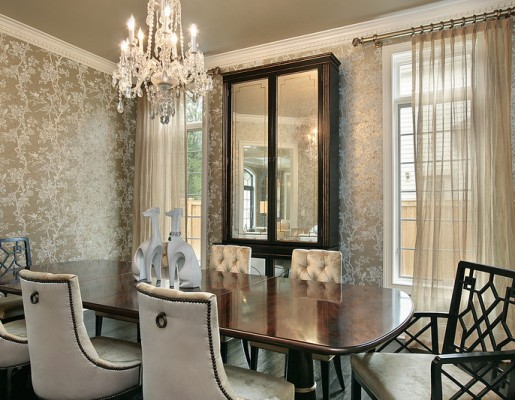 Sparkling wallpaper, crystal chandelier, and comfortably upholstered chairs is all that is needed to create a majestic dining room.